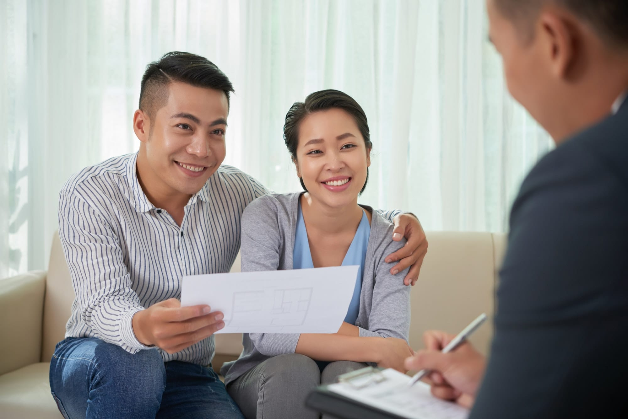 Asian couple meeting with broker